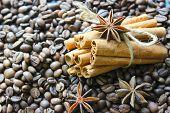 Cinnamon Sticks And Coffee Beans Closeup. Aromatic Coffee - Coffee Beans And Cinnamon Sticks. Backgr poster
