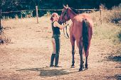 Animal And Human Love, Equine Concept. Jockey Woman Walking With Horse On Meadow poster