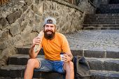 Delicious Food To Fit His Lifestyle. Caucasian Guy Traveler Enjoying Street Food Cuisine. Bearded Ma poster