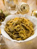 spaghetti carbonara with artichoke on christmas table