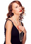 Portrait of beautiful elegant woman with red lipstick and beautiful pearl necklace. Isolated on whit