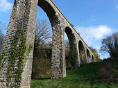 stock photo of poitiers  - Arched Roman aqueduct near Poitiers in France - JPG