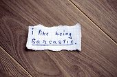 stock photo of sarcastic  - I like being sarcastic written on piece of paper on a wood background - JPG