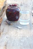 picture of tumbler  - glass pot with sweet preserve of red berry spoon and tumbler with clean cool water - JPG