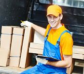 young male postal delivery courier man in front of cargo van delivering package