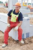 One adult smiling happy construction worker at building area