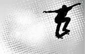 skateboarder silhouette on the abstract halftone background