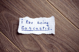 pic of sarcastic  - I like being sarcastic written on piece of paper on a wood background - JPG