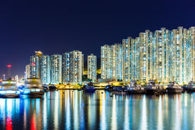pic of overpopulation  - Overpopulated apartment building at night - JPG