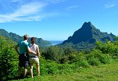 pic of french polynesia  - Young honeymoon couple with an overview over Rotui mountain and Opunohu Bay on the tropical pacific island of Moorea near Tahiti in French Polynesia - JPG