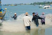 Vietnamese Fishers Untangle Nets