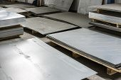 picture of tin man  - sheet tin metal in production hall abstract industry