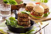 stock photo of veggie burger  - Vegan burgers with  beans and vegetables served with spinach