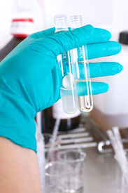 stock photo of hplc  - Picture of a person working in a lab - JPG