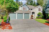pic of driveway  - Luxury house exterior with three car garage and driveway - JPG