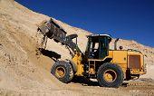 picture of wheel loader  - Front end loader machine digging up sand - JPG