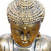 stock photo of siddhartha  - golden buddha face isolated on white close up - JPG