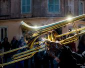 stock photo of trombone  - A street musician plays in the streets of New Orleans while smoking - JPG