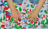 pic of finger-painting  - Kid paints with her fingers with different color paint - JPG