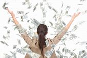 stock photo of american money  - Young business woman and money banknotes flying in air on the white background - JPG