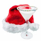 picture of sprinkling  - A white cocktail with sprinkles and a red santa christmas hat
