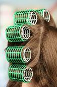 image of hair curlers  - Long female hair during hair dressing with curler - JPG