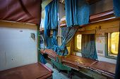stock photo of railroad car  - Inside a grungy and uncomfortable passenger car aboard a train in India - JPG