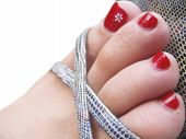 picture of painted toes  - Womans foot in the footwear with decorated painted nails isolated on the white background - JPG