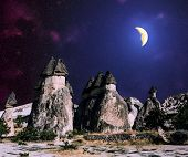 stock photo of moonlight  - Volcanic rock formations of Cappadocia under the starry sky and the Moonlight Turkey - JPG