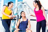 pic of tease  - Women teasing man at gym - JPG