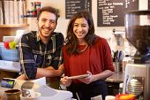 picture of hot couple  - Portrait Of Couple Running Coffee Shop Together - JPG