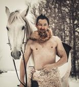 stock photo of beast-man  - Portrait of a wild man at winter day - JPG