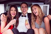 image of limousine  - Pretty girls with ladies man in the limousine on a night out - JPG