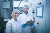 image of process  - Food technicians working together in a food processing plant - JPG
