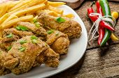 stock photo of fried onion  - Fried chicken chilli fries and dip and spring onions on top of meal - JPG