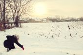 foto of finger-painting  - woman in winter clothes in snow drawing with finger love copy space outside on sunny cold winter vintage day - JPG