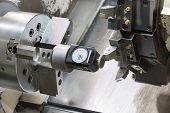 pic of machine  - Operator setup tool and setting tool zero position of CNC turning machine before machining - JPG