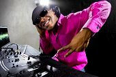 image of deuce  - Cool African American male DJ playing music at a party - JPG