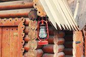 picture of kerosene lamp  - Kerosene lamp hanging on wooden house - JPG