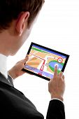 image of tablet pc computer  - businessman holding a touchpad pc using the navigation programme isolated on white  All Texts - JPG