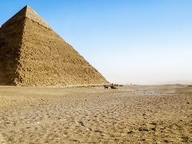 pic of sandstorms  - Against the background of the Great Pyramid of riders and sandstorm - JPG