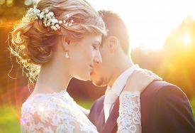 image of marriage ceremony  - Young wedding couple enjoying romantic moments outside on a summer meadow - JPG