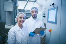 image of food plant  - Food technicians working together in a food processing plant - JPG