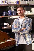 picture of cash register  - Portrait Of Male Barber Standing By Cash Register - JPG