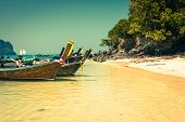 image of phi phi  - Thai traditional boats on Phi - JPG