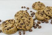 pic of chocolate-chip  - Chocolate chip cookies and chocolate grains on white - JPG