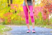 picture of muscle pain  - Muscle injury of female sports runner thigh - JPG
