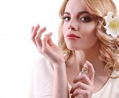 stock photo of perfume  - Beautiful young woman with perfume bottle isolate on white - JPG