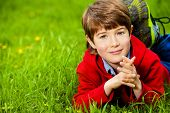 picture of 7-year-old  - Cute 7 years old boy having fun outdoor - JPG