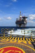 pic of offshore  - Offshore Jack Up Drilling Rig Over The Production Platform in The Middle of The Sea  - JPG